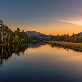 Autumn scenery at sunset reflected in the water of the river by Jan Gorzynik - Landscapes Sunsets & Sunrises ( calm, concept, reflection, seasonal, bright, colorful, vibrant, travel, leaf, beauty, landscape, tranquil, sky, nature, autumn, serenity, foliage, idyllic, light, water, orange, peaceful, park, lush, forest, lake, tourism, scenic, woods, rural, stillness, wilderness, season, blue, color, fall, outdoor, trees, october, tranquility, natural, lake placid )
