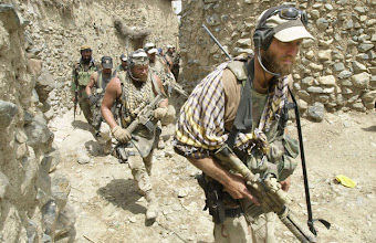 Photo: U.S. ODA, Operational Detatchment A-Team Special Forces Group walks through a vilage in Narizah, Aug. 22, 2002, 140 kms. (86 miles) east of the capital Kabul. U.S. Special Forces were first to enter villages in Southeastern Afghanistan during Operation Mountain Sweep. More than 2,000 troops took part in the operation. (AP Photo/Wally Santana)