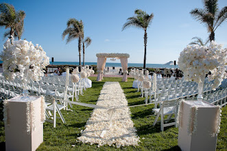 Photo: A grand wedding ceremony overlooking the sparkling Pacific Ocean.