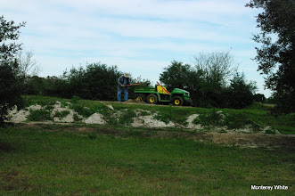 Photo: Bill Howe digging up dirt for Carolyn Balkum's siding.  No tractor in sight.     2009-1127 HALS Anniversary Meet