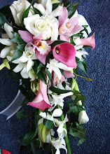 Photo: [B16] Cascade bouquet featuring mini calla lilies, white roses, pink and white cymbidium and dendrobium orchids