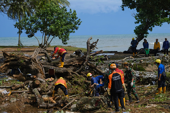 Rescue workers clear debris left by a by a tsunami at a resort hotel on December 24 2018 in Tanjung Lesung, Indonesia. Picture: GETTY IMAGES/ ED WRAY