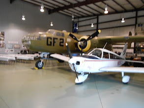 Photo: The B-25 and Ken Berry's Cherokee share the hangar; Cantzon Foster keeps his C-172 here too