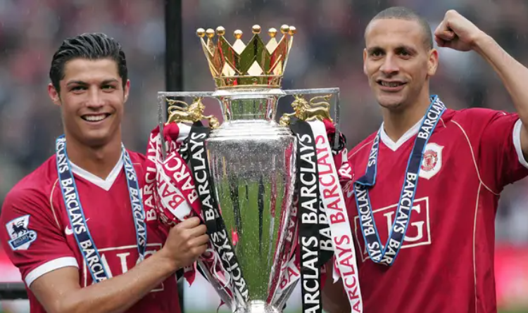 Cristiano Ronaldo and Rio Ferdinand holding the Premier League trophy