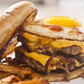 1/2 LB Double Cheeseburger with fried egg, sautéed onions and BBQ sauce