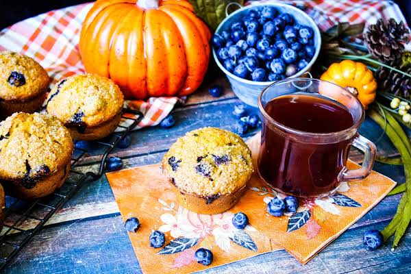 Blueberry Pumpkin Southern Comfort Muffin With A Cup Of Tea.