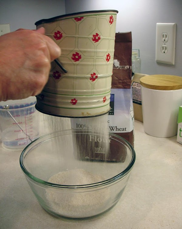 Sift the flour, baking powder and salt together.  Add a portion of flour...