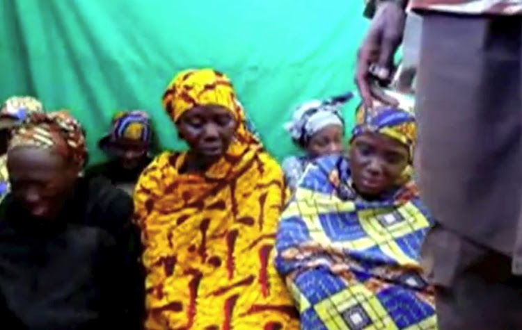 Remaining girls who were kidnapped from the northeast Nigerian town of Chibok are seen in an unknown location in Nigeria in this still image taken from an undated video obtained on January 15, 2018.