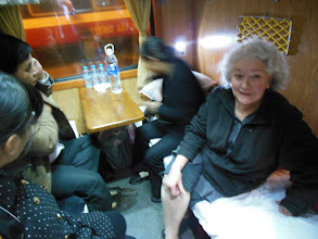 Photo: On the train Hanoi to Lao Cai to catch bus to Sapa. Leslie is on her bunk and the woman next to her just sat down on LK's bunk. This is what Leslie looks like when she really has no idea of what to do
