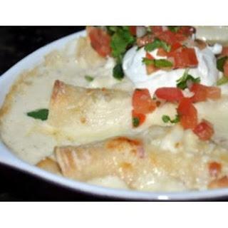 Shrimp and Scallop Enchiladas With Tomatillo Cream Sauce.