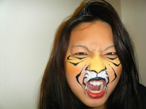 Photo: Tiger face paint by Heidi, La Verne. Book Heidi by calling 888-750-7024
