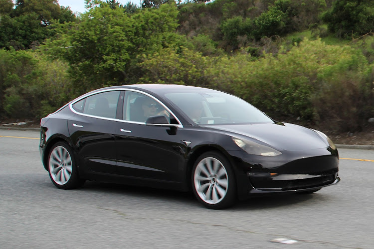 The production version of the Tesla Model 3 features a design more similar to the Model S