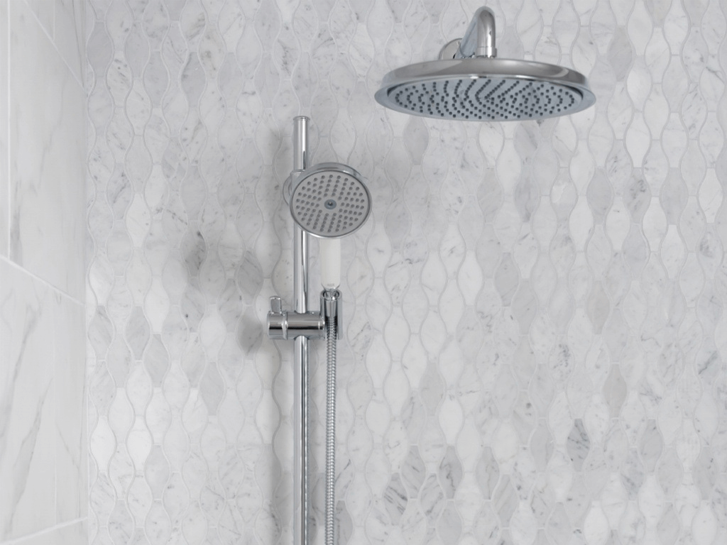 Light marble-look mosaic tile shower wall