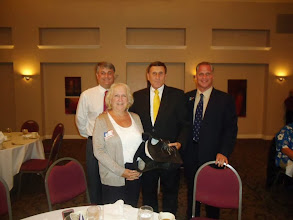 Photo: Immediate Past President Eric Sanders, Sergeant-at-Arms Patricia Northey, Congressman John Mica, and newly installed President of our club, Wayne Zimmerman - June 14, 2013