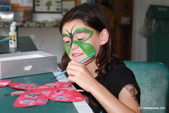Photo: Painting a butterfly to match her face at Grand Isle State Park by Julie Lyman