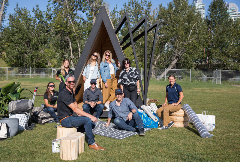 LeAnne Bunnell Interiors and team helping build stargazer reading fort for kids cancer care camp kindle