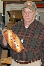 Photo: Bob Grudberg shows his open segmented vase.