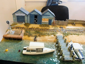 Photo: 012 The first of 3 photos which will show the whole of Port Sapple Marine. Starting on the left of the layout we find some huts, a tiny landing pier and a scratchbuilt pair of motor boats .
