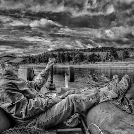 Relaxed fishing by Joe Saladino - Black & White Portraits & People ( fishing, monochrome, black and white, man, clouds, water, lake, boat )