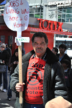 Photo: A man demands jobs and a living wage for the people of Toronto.