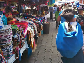Photo: Local ladies in their normal dress in Otavalo, Ecuador. An exciting lively marketplace bursting with color.