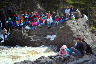 Photo: Spectators await another kayaker to cheer on during the Lester River Race.