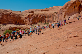Photo: More of the group arrives to the base of Corona Arch during the Passover in Moab Seder.