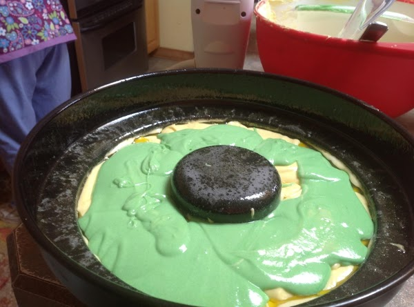 Now add about half of the green cake batter, then top with the remaining...