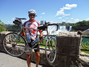 Photo: Day 46 August 3 2013 Brantford ON to Niagara Falls NY On the Canadian side of falls Jim holding Bob Render's bike