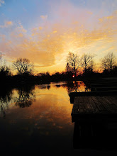 Photo: Dark docks and trees against a fiery sunset and lake at Eastwood Park in Dayton, Ohio.