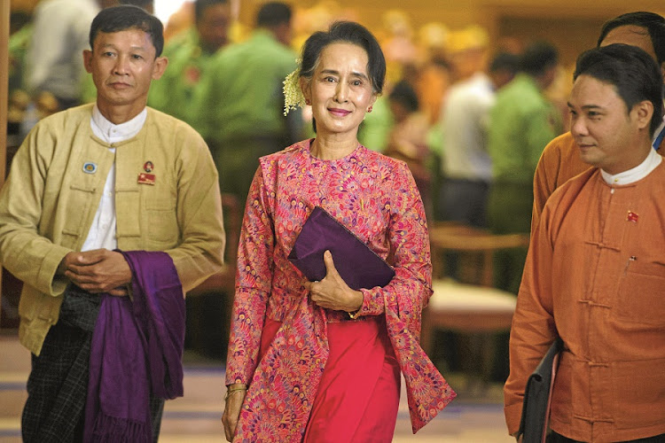 Myanamar's National League for Democracy chair Aung San Suu Kyi arrives for the new lower house parliamentary session where her chosen MPs were sworn in. This comes after her election victory in November last year. Picture: GALLO IMAGES/AFP/YE AUNG THU