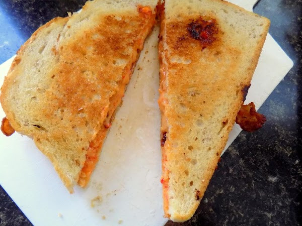 Remove sandwich from the griddle/frying pan to a cutting board. Allow to rest for...