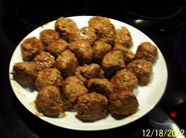 Lightly combine meatball ingredients.Form into 20-24 meatballs.In a large skillet. brown in oil.Remove meatballs....