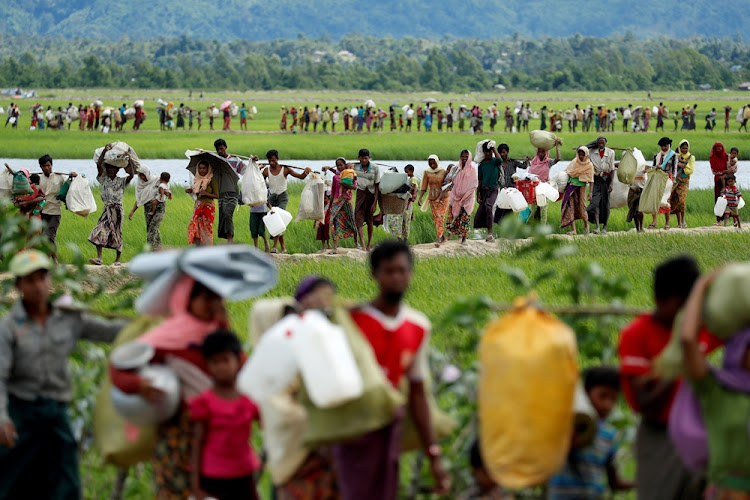 Rohingya refugees walk to the refugee camps, in Palang Khali, near Cox's Bazar, Bangladesh on October 19, 2017. File Photo.