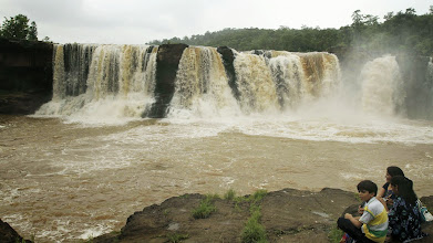 Photo: An Indian family sits watching the Gira waterfalls which is in full flow following monsoon rains near Saputara in Dang district of Gujarat state, India. The Western state of Gujarat is currently holding the month long Saputara monsoon festival aimed at promoting tourism. AP Photo