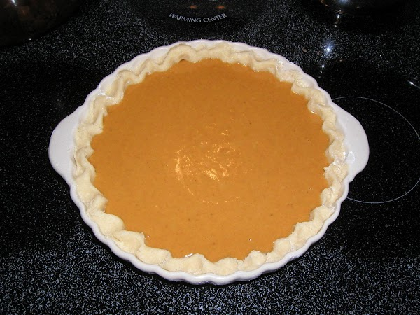 Pour filling into unbaked deep dish pie shell and bake at 400 degrees F....