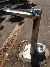 Photo: Where we also came across this great idea! A drinking fountain where the excess pours into the dog bowl at the bottom (which can be quickly lifted and emptied to refresh). What an excellent idea! They need these everywhere!