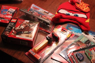 Photo: Now the question is... how do we fit all these goodies into the stocking?