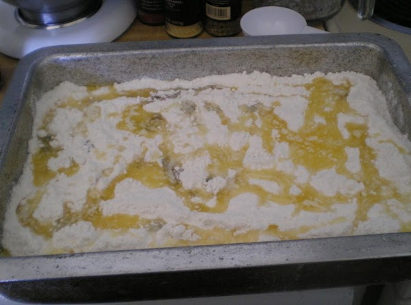 Pour melted butter evenly over the top of cake mix.