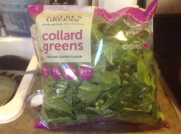 Remove lid and add collard greens, then add the garlic powder red pepper flakes,...