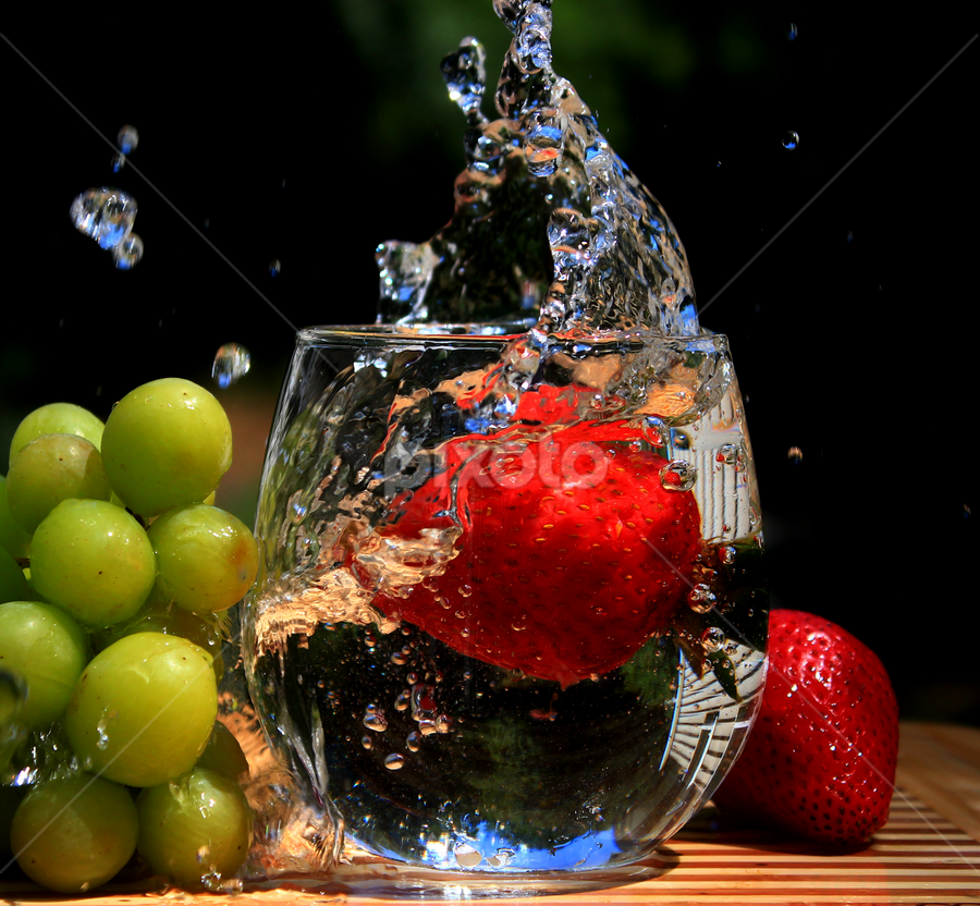 Sparkling cold water by Dipali S - Food & Drink Alcohol & Drinks ( water, reflection, sparkling, splash, cold, strawberry, pwccolddrinks )