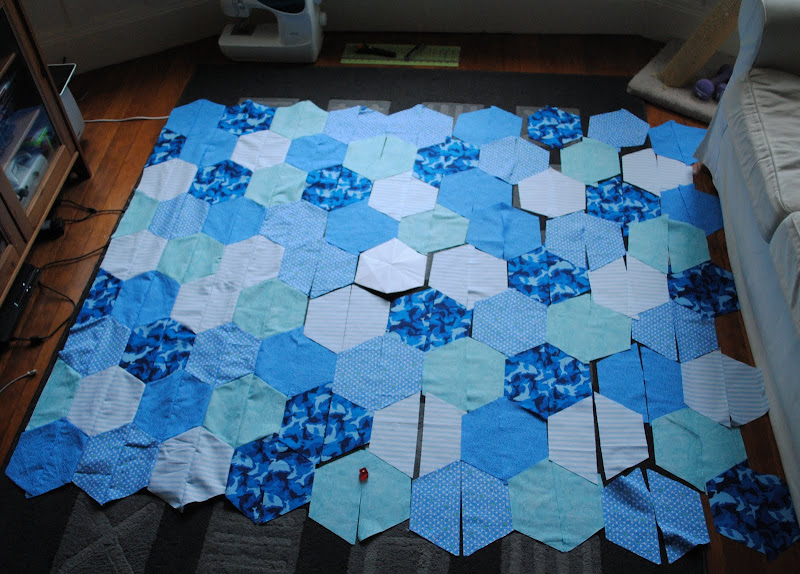 Photo: Base for Catan quilt, rolling dice to randomize tiles