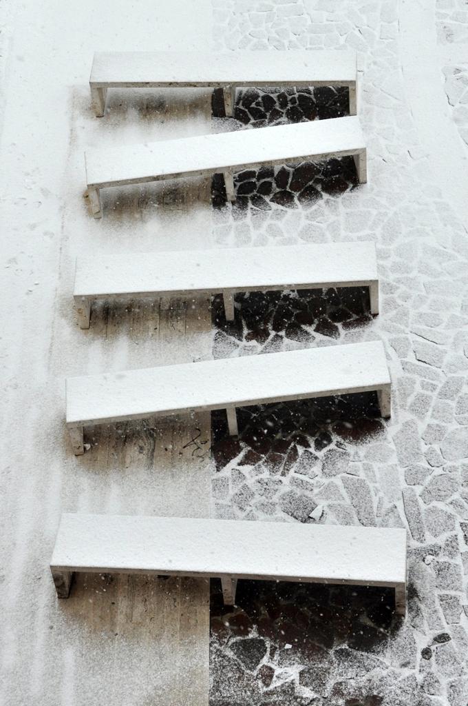 Panchine sotto la neve di ciubecca