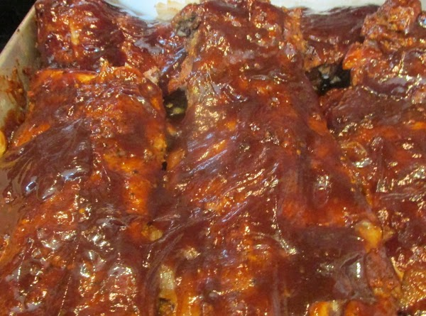 Baste Ribs with Barbeque sauce, and return to oven to bake for an additional...