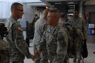 Photo: Col. Kevin Gerdes, Minnesota Director of Personnel, greets returning OMLT member Sgt. Matthew Suchoski as he enters the airport with other members of the team.  Twelve Soldiers making up the Operational Mentoring Liaison Team (OMLT) from the Minnesota Army National Guard return from a one-year deployment to Afghanistan in support of Operation Enduring Freedom on Nov. 5.