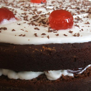 Chocolate Cake Garnished with Cherries Filled with Chantilly Recipe