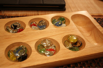 Photo: Mancala! I played ruthlessly against a teenager. My life is sad.