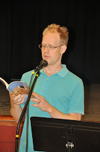 "Photo: Shane Guthrie reads ""For the Crime of Poetry."""