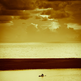 Torn Between Two Waters by Bong Flores - Landscapes Sunsets & Sunrises ( clouds, sunset, sea, beach, fishing, boat )