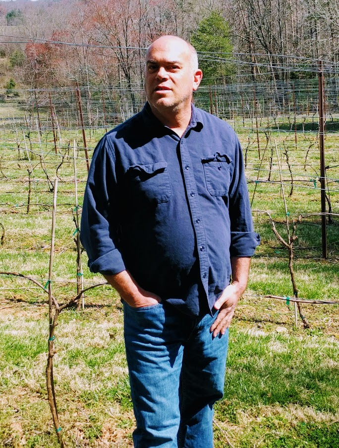 Sean McRitchie in the vineyard